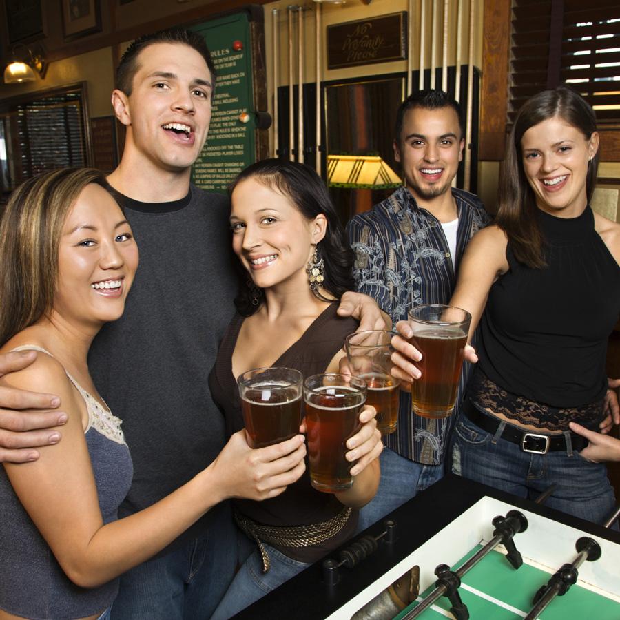 Fooseball and beer at a bar